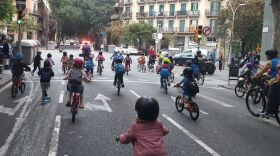 Children joining the <em>bicibus</em> in the Eixample district of Barcelona make their way to school on a recent Friday morning. The community is hoping to build a school-friendly bike lane for a safer commute for kids.