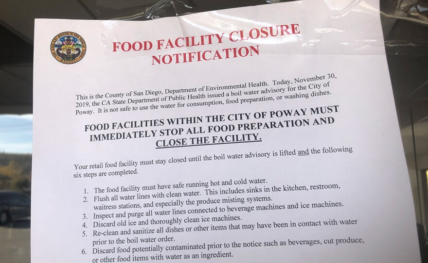 A notice of closure on the door of a Poway restaurant on Dec. 2, 2019, because of the water contamination.