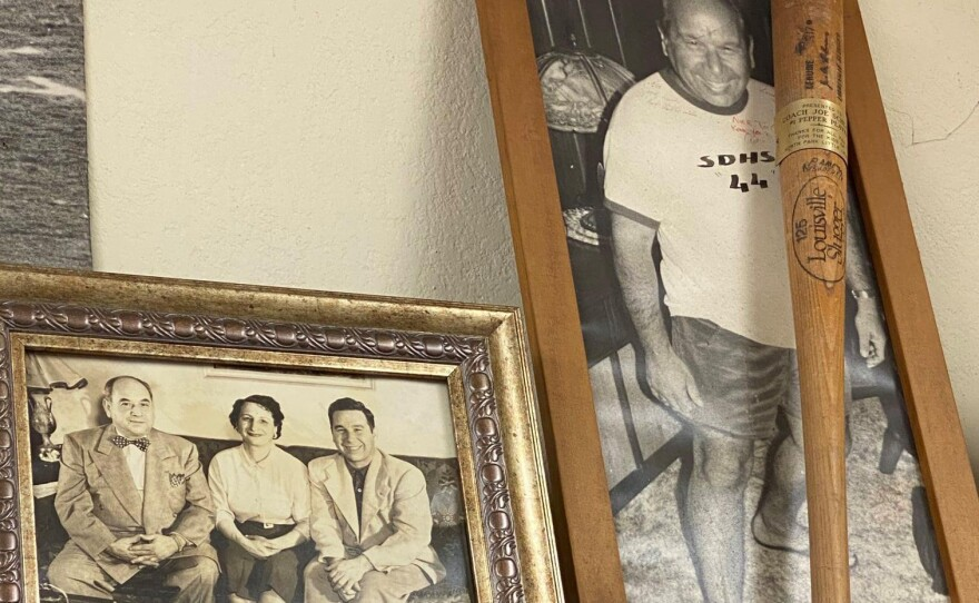 Photos hang on the walls of A&B Sporting Goods in North Park show previous generations of the Schloss family, Jan. 2021.