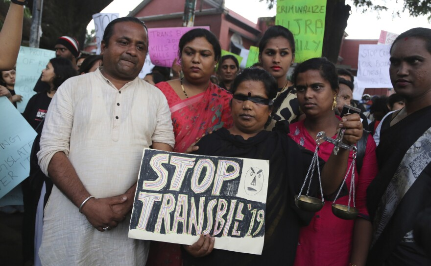 Supporters of lesbian, gay, bisexual and transgender community hold placards during a protest against passing of Transgender Persons (Protection of Rights) Bill, 2019, in Bangalore, India, Wednesday, Nov. 27, 2019. Members of the LGBT community alleged that the bill violated their rights instead of empowering them. The bill was passed in upper house of Indian parliament on Tuesday.