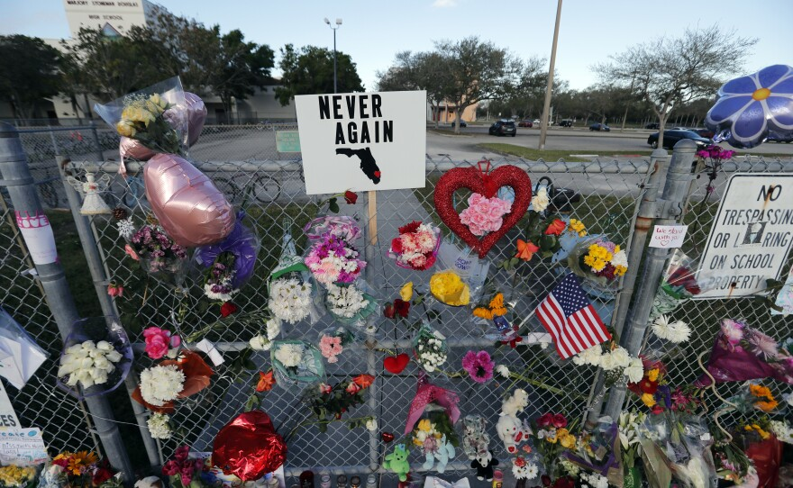 A makeshift memorial is seen outside the Marjory Stoneman Douglas High School, where 17 students and faculty were killed in a mass shooting on Wednesday, in Parkland, Fla., Monday, Feb. 19, 2018.