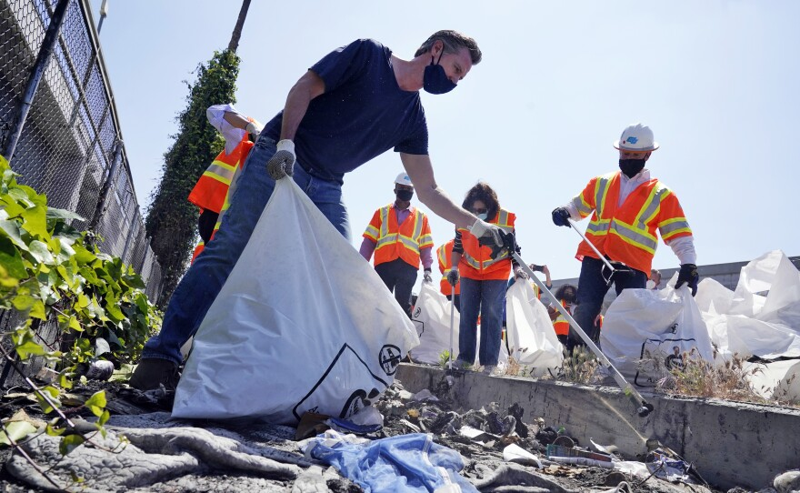 California Gov. Gavin Newsom joins a cleanup effort in Los Angeles, May 11, 2021.