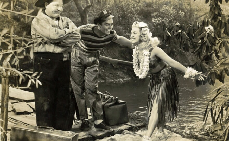"""Jackie Oakley, Victor Mature, and Betty Grable in """"Song of the Islands"""" (1942), an example of South Seas Cinema from Hollywood."""