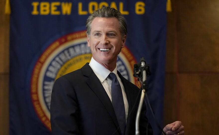 Gov. Gavin Newsom speaks to volunteers in San Francisco, Tuesday, Sept. 14, 2021.
