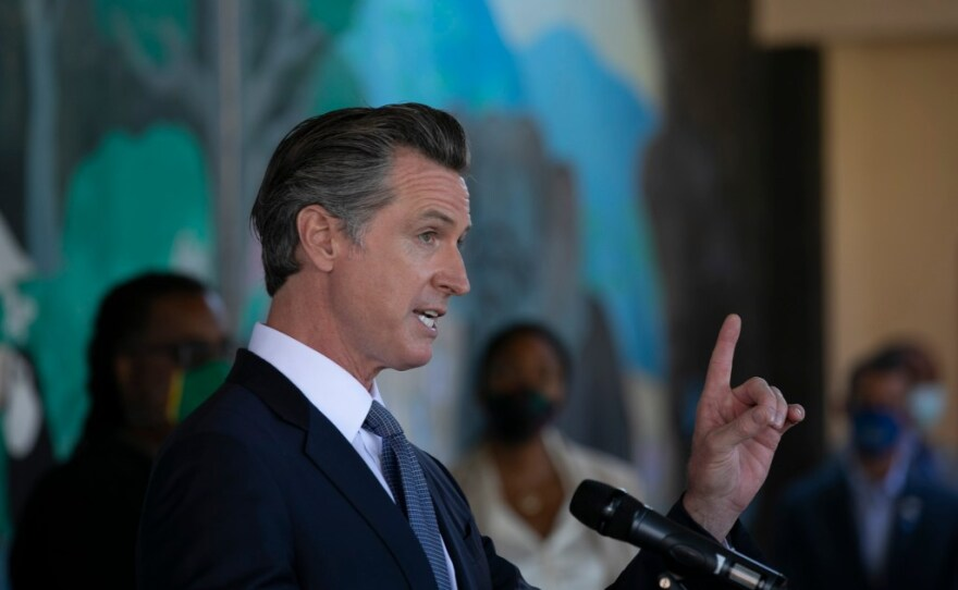 Gov. Gavin Newsom announces all school teachers and employees will be required to be vaccinated or undergo weekly COVID-19 testing at a press conference at Carl B. Munck school in Oakland on Aug. 11, 2021.