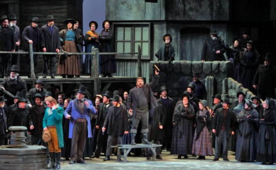 Greg Fedderly as Bob Boles (centre) with the San Diego Opera chorus in 'Peter Grimes'. Photo © 2009 Ken Howard