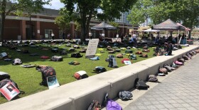 """Backpacks spread throughout Curran Plaza at San Diego City College for the """"Send Silence Packing"""" suicide display, May 9, 2018."""