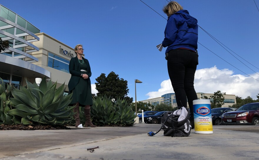 Inovio Pharmaceuticals Senior Vice President of Research and Development Kate Broderick speaks with KPBS Health Reporter Tarryn Mento outside the company's Sorrento Valley lab, March 17, 2020.