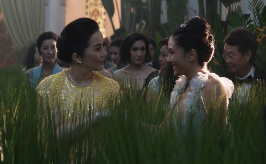 In the movie Crazy Rich Asians, Princess Intan (Kris Aquino, left) and economist Rachel Chu (Constance Wu) meet at a wedding in Singapore and have a little tete-a-tete about, of all things, microloans.