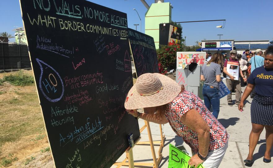 Chalkboards at an immigrant-rights rally hold suggestions on what border communities need instead of a wall, April 21, 2017.