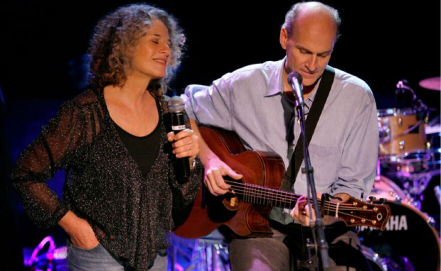 Carole King and James Taylor performing on stage together at the Troubadour nightclub in Los Angeles. (2007)