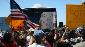 Protesters in Murrieta block the path of a charter bus containing migrants who entered the country illegally, July 1, 2014.