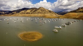 Houseboats float on Lake Oroville, Monday, Oct. 25, 2021, in Oroville, Calif. Recent storms raised the reservoir more than 16 feet, according to the California Department of Water Resources.