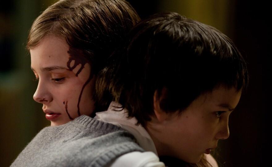 """Chloe Grace Moretz and Kodi Smit-McPhee star in """"Let Me In."""""""