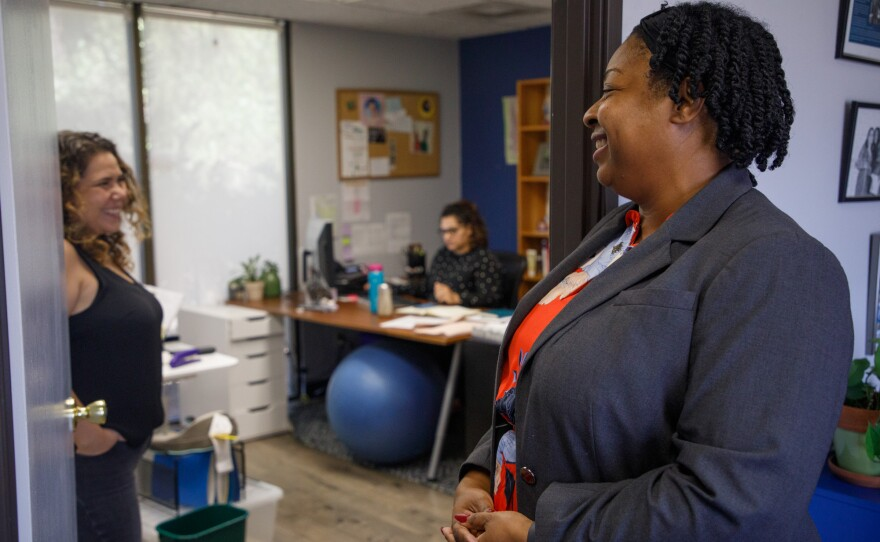 Kyra Greene, executive director at the Center on Policy Initiatives in San Diego, is photographed speaking with colleagues at the nonprofit's offices on Aug. 13, 2019.