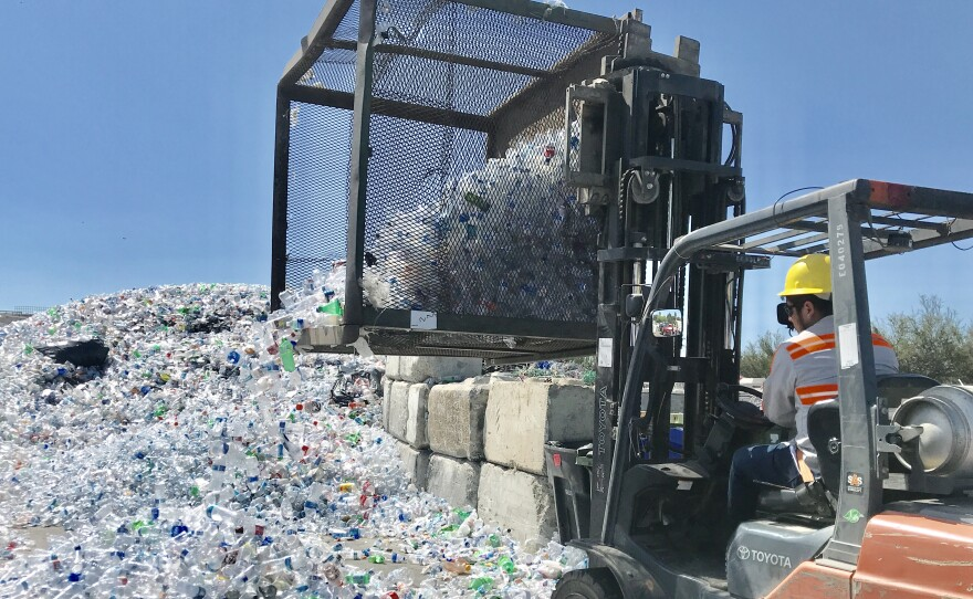 Plastic bottles pile up at the Miramar Recycling Center, Aug. 26, 2019.
