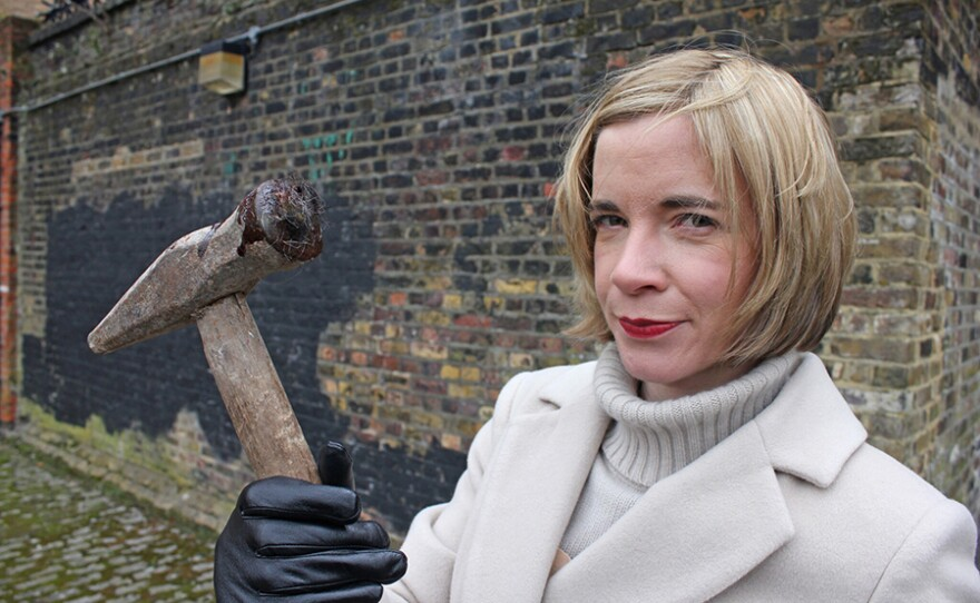 Lucy Worsley with Ratcliff Highway murder weapon in A VERY BRITISH MURDER.