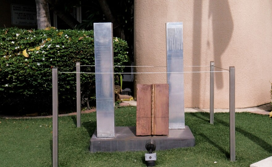 A memorial depicting the World Trade Center towers with a piece of steel from the actual towers in the middle is shown outside Fire Station 21 in Pacific Beach on September 2, 2021.