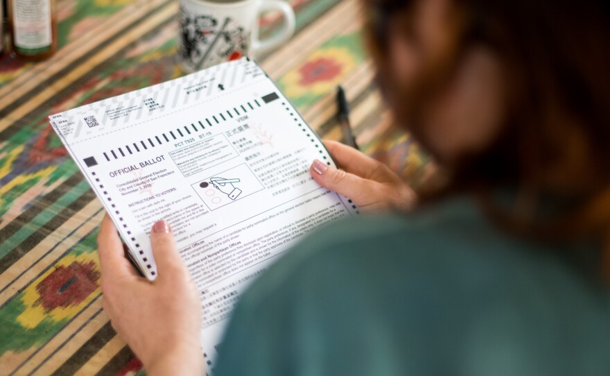 A San Francisco resident fills out their mail-in ballot on Oct. 6, 2020.