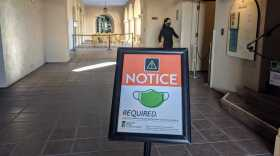 A sign indicating masks were required at The Prado restaurant in Balboa Park, Dec. 5, 2020.