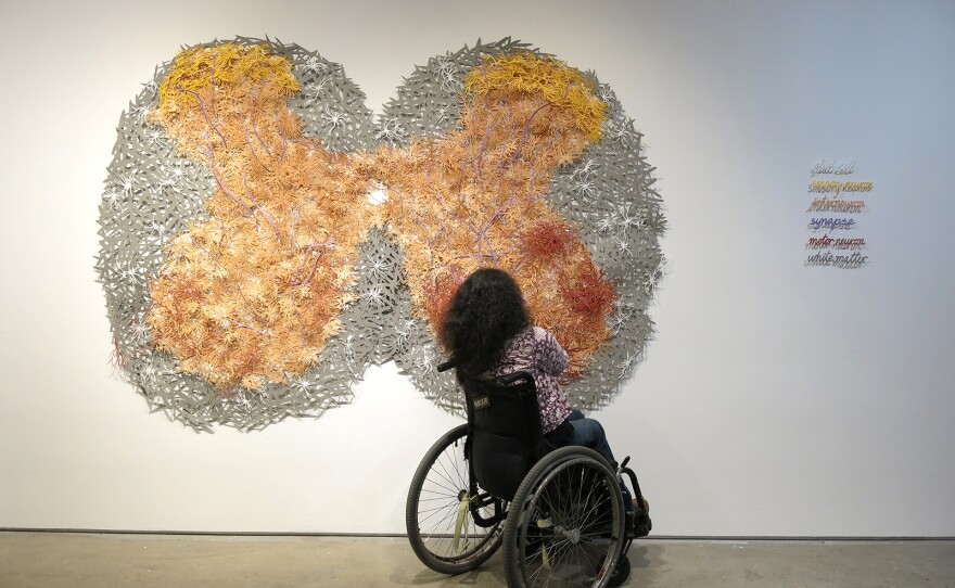 """Artist Bhavna Mehta is pictured with her new installation, """"Fault Lines,"""" at SDAI."""