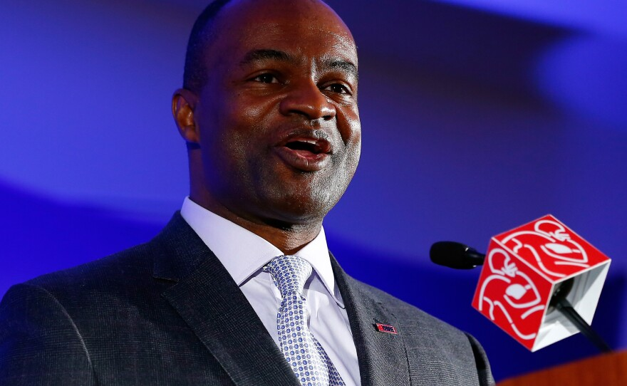 DeMaurice Smith, executive director of the National Football League Players Association, speaks during a news conference in 2014.