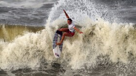 In this July 27, 2021, file photo, Carissa Moore, of the United States, preforms on the wave during the gold medal heat in the women's surfing competition at the 2020 Summer Olympics at Tsurigasaki beach in Ichinomiya, Japan.