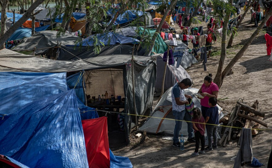 Clothing hangs to dry at a makeshift migrant camp for asylum seekers in Matamoros, Tamaulipas state, Mexico, on earlier this month. About 60,000 migrants live in filthy and dangerous conditions as they await their day in U.S. immigration court.