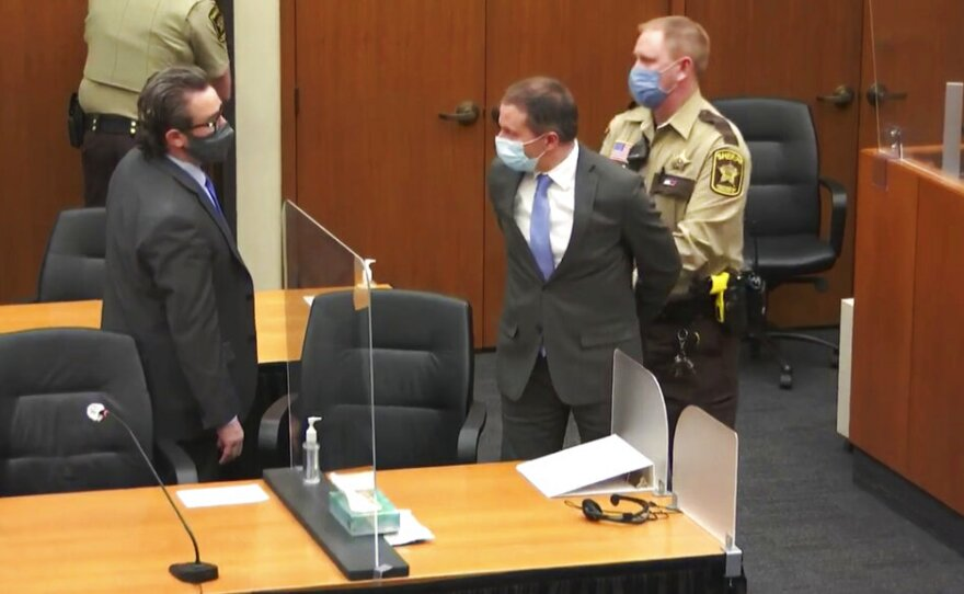 In this image from video, former Minneapolis police Officer Derek Chauvin, center, is taken into custody as his attorney, Eric Nelson, left, looks on, after the verdicts were read at Chauvin's trial for the 2020 death of George Floyd, Tuesday, April 20, 2021, at the Hennepin County Courthouse in Minneapolis, Minn.