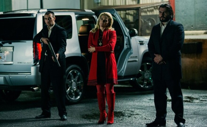"""Kate Winslet (center) plays a woman who ruthlessly runs a Russian mob in her husband's absence in """"Triple 9."""""""