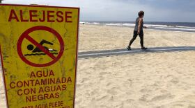 Pedestrians return to Imperial Beach after sand was closed because of COVID 19, but people are not cleared to get in the water on April 29, 2020.