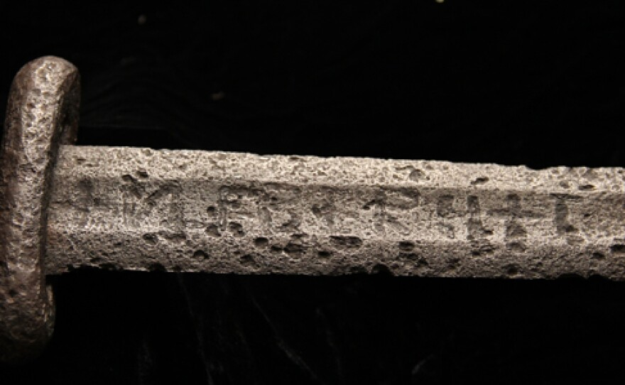 An original Ulfberht sword at the National Museum in Copenhagen, Denmark. The sword is dated from the 10th century and bears the inscription +VLFBERH+T. According to archeometallurgist Alan Williams' research, Ulfberht swords with the +T inscription were made from crucible steel, a pure kind of steel not known in Europe during the Viking Age.