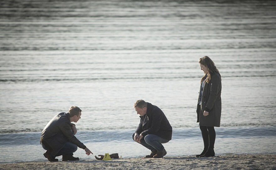 A severed hand washes up on a beach in a scene from SHETLAND Season 5.