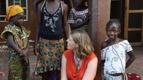 Erica Ollmann Saphire, a professor with the La Jolla Institute for Immunology, talks to children in Africa on a recent trip to the region to study Ebola in this undated photo.