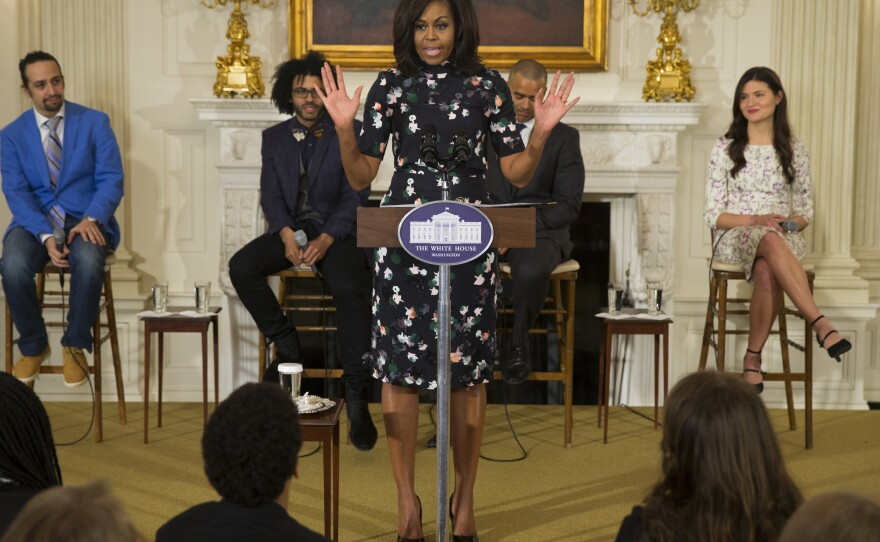 """First lady Michelle Obama speaks during an event with the cast of the Broadway play """"Hamilton"""" at the White House in 2016."""