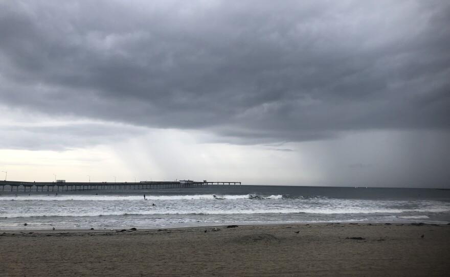 Storm clouds over the Ocean Beach Pier, Nov. 19, 2019.