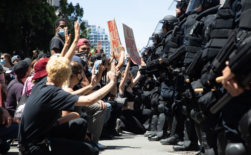 San Diego police officers block demonstrators during a protest of police violence and the killing of George Floyd in Minneapolis, May 31, 2020.