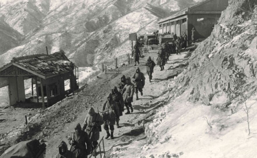 U.S. Marines march along a mountain road as they withdraw south through the Funchilin Pass in North Korea. Dec. 10, 1950.