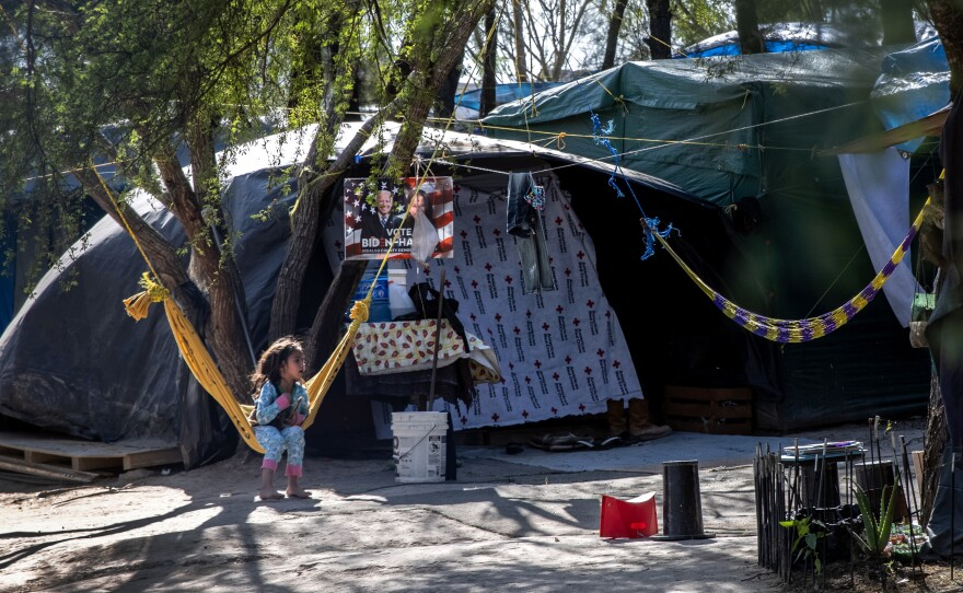 A Salvadorian girl sits inside a camp for asylum seekers on Feb. 07 in Matamoros, Mexico, where some 600 people who left Central America have been waiting for immigration court hearings.