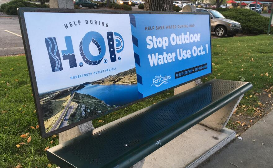 A sign in Fort Collins, Colo. urges residents to curb their outside water use, partially in response to the potential for wildfire runoff from the Cameron Peak Fire, in this Oct. 2020 photo.