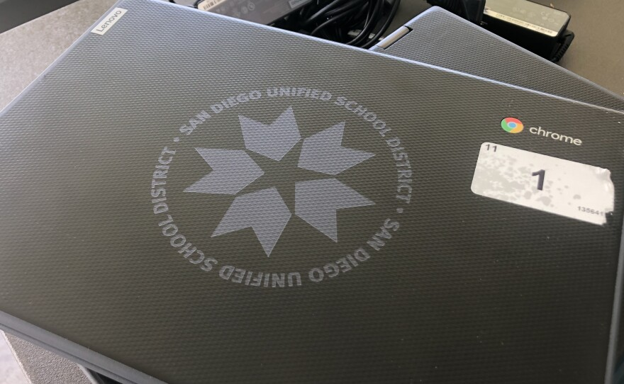 A computer provided by the San Diego Unified School District for a distance learning distribution at Clairemont High School on April 21, 2020.