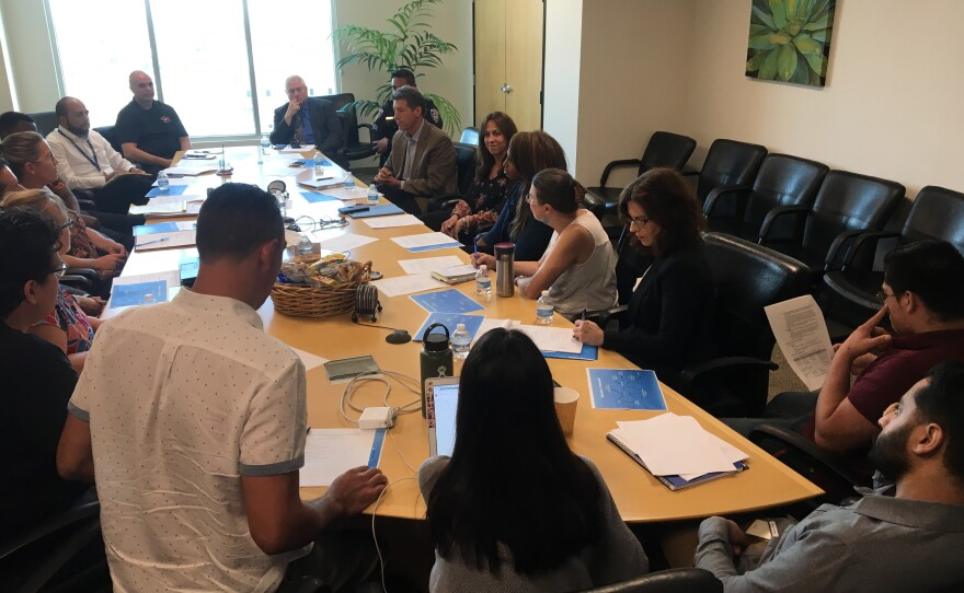 Members of the Restorative Community Conferencing Committee sit around a conference table to discuss expanding the program, August, 27, 2018.