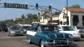 Cars cruise beneath the Encinitas sign on South Coast Highway, 2013
