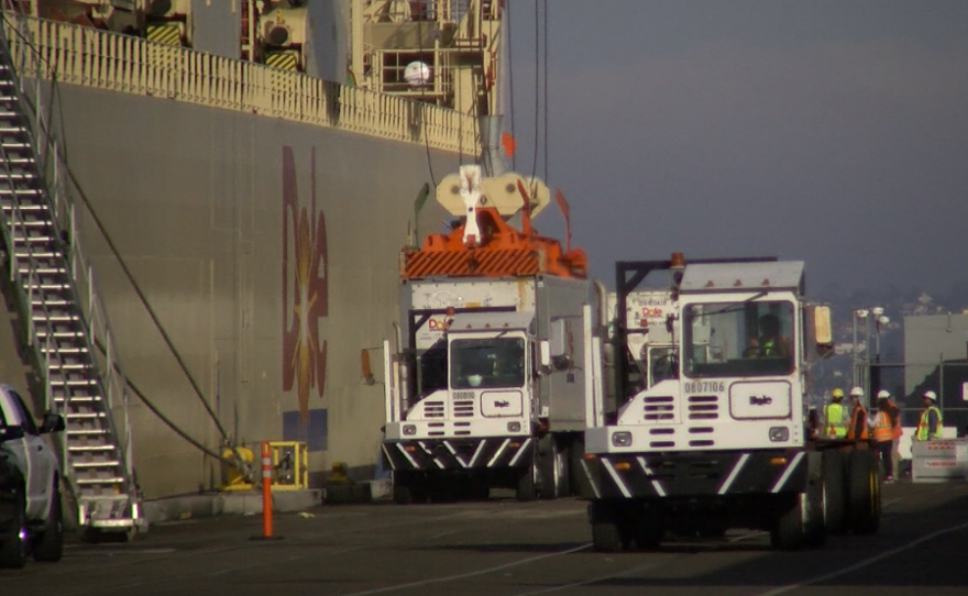 Trucks unload a ship carrying Dole fruit to the 10th Avenue Marine Terminal on Sept. 19, 2016.
