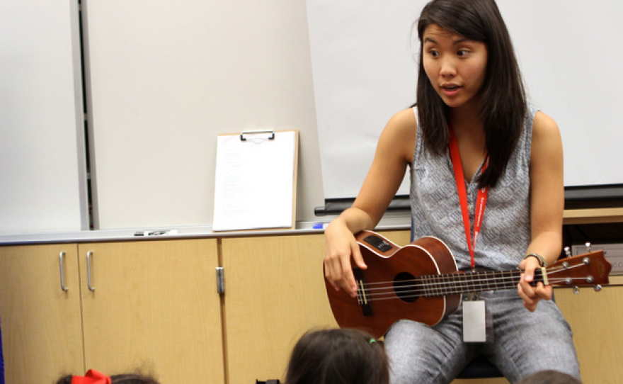 Zoe Kumagai, 23, a new music teacher at Veterans Elementary School in Chula Vista, California, instructs a group of kindergarten students.