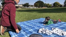 Mayumi Nara and her son Yuki play at the Allied Gardens Park on Dec. 15, 2020.