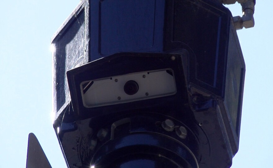 A camera is seen on a streetlight in the city of San Diego, Sept. 17, 2019.