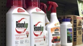 Containers of Roundup, left, a weed killer is seen on a shelf with other products for sale at a hardware store in Los Angeles on Jan. 26, 2017.