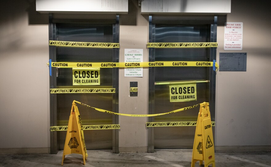 Elevators from the parking garage at La Maestra Community Health Centers' City Heights clinic are closed off with caution tape to ensure all visitors enter through a COVID-19 screening point, April 8, 2020.