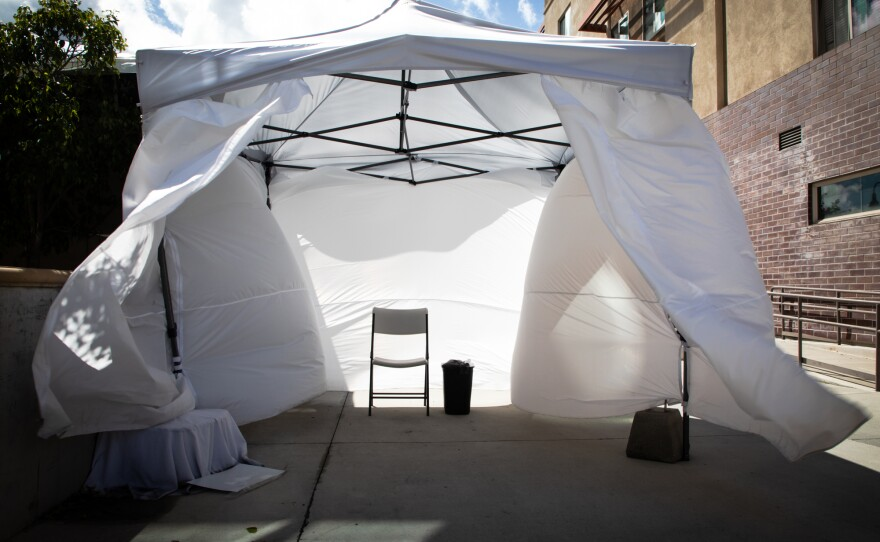 Wind blows through an empty isolation tent set up for patients who arrive at La Maestra Community Health Centers' City Heights clinic with COVID-19 symptoms, April 8, 2020.